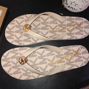 Micheal Kors Cream Flip Flops with Gold Emblem